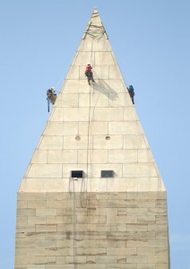 A team of engineers, harnessed to ropes, inspect the exterior of the Washington Monument on Wednesday, September 28, 2011(AP Photo/Evan Vucci).