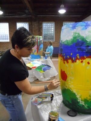 Artist Loraine Dunn, art director of the Mt. Airy Art Garage, paints a rain barrel. | Photo: courtesy of Mt. Airy BID