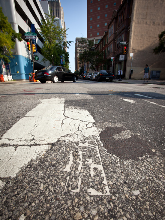 Tile preserved by crosswalk paint | Photo by Steve Weinik