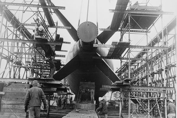 "photo via NewsWorks: ""December 18, 1972: A submarine undergoing repairs at the Philadelphia Naval Shipyard. (Library of Congress, photographer unknown)"""