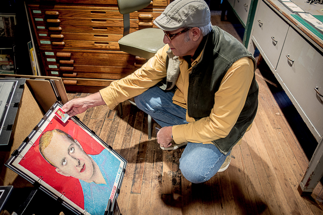 Historian Todd Kimmel shows a small scale print of actor Frank Mayo along, with his digitally enhanced and enlarged print for sale | Photo: Theresa Stigale