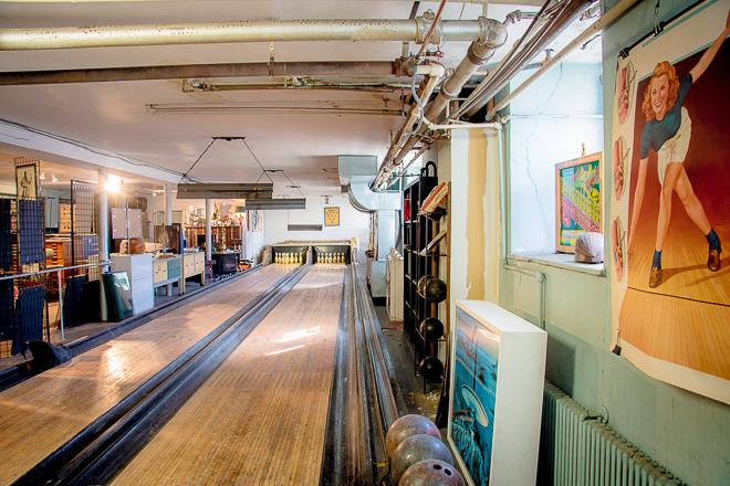 Vintage two-lane bowling alley in the studio and showroom of The Grand Review | Photo: Theresa Stigale