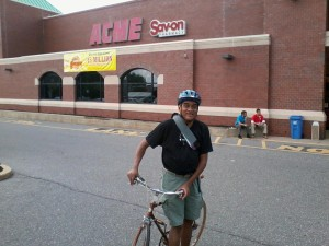 The author, on a supermarket run in his Oxford Circle neighborhood this past summer. The store's easy to bike to, but where does one put the bike once there?