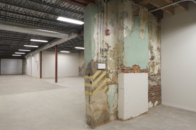 Looking from the former church space to the former dye shop space—and into new craftsman space | Photo: Peter Woodall