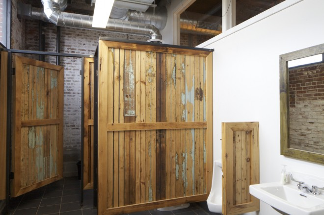 Don't forget to wash your hands: reclaimed materials in the men's room | Photo: Peter Woodall