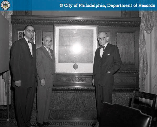 We're so excited! Public Property Commissioner William T. Gennetti, with Grant Simon of the Historical Commission and an unidentified third man, at the unveiling of the Charter at City Hall, 1960. | Photo: PhillyHistory.org.