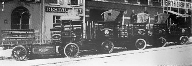 1913: Theodore Finkenauer's fleet of electric delivery trucks sit parked in front of the stable that previously kept its delivery horses. The building's brewing history will soon resume with Saint Benjamin | Image: The Power Wagon, February 1, 1913