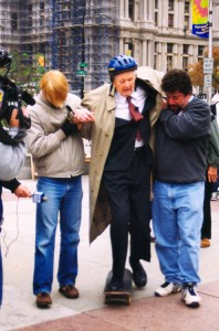 Never one to back down from a strong opinion, then-92-year-old Ed Bacon rode a skateboard to protest Mayor John Street's ban on the practice which made LOVE Park so popular with skaters. On Bacon's left is Howard Altman, former Editor of City Paper | Image: Edmund N. Bacon Collection, The Architectural Archives, University of Pennsylvania