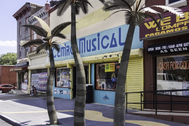 Centro Musical, the heart of Philly Latino music at 5th & Lehigh, accented by palm tree sculptures and the golden sidewalk | Photo: Theresa Stigale