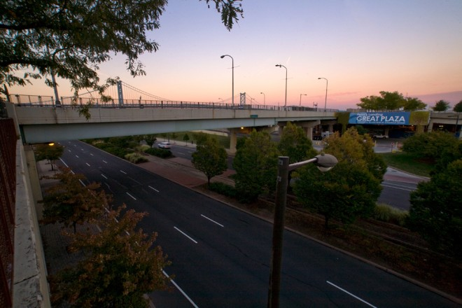 The same view, looking northeast toward the Ben Franklin Bridge, where a cap over Columbus Blvd will create public space between Walnut and Chestnut Streets, sloping toward the Delaware River   Photo: Bradley Maule