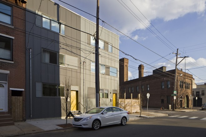 The fire station at right was  rehabbed a decade ago. Now there is a wave of new construction, as at left   Photo: Peter Woodall
