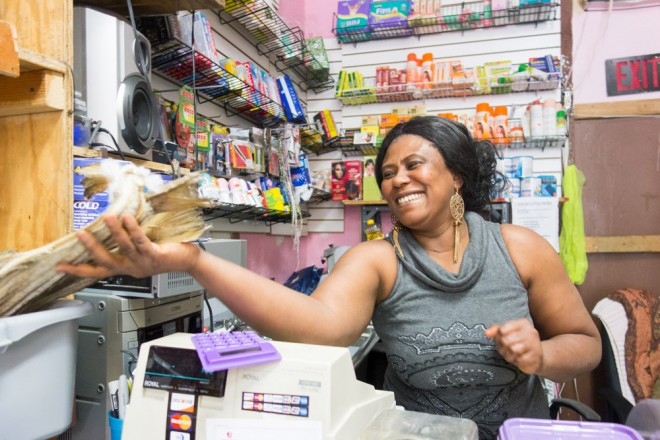 Mariann Viassy, owner of Bantu African Imports on S. 60th Street, with dried stock fish for soup | Photo: Theresa Stigale