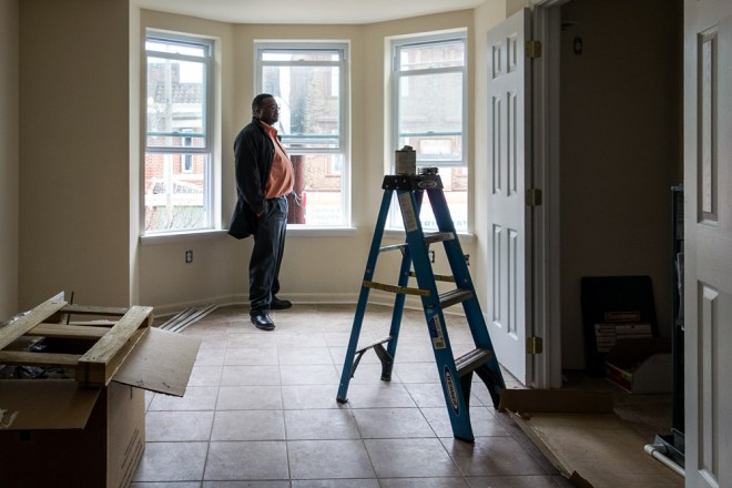 Steve Williams inside a one bedroom unit above a store, under renovation by The Partnership CDC for affordable housing | Photo: Theresa Stigale