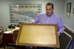"Standing in the small office of the Tacony Historical Society, Lou Iatarola holds a hand drawn plan of Shuman's Cairo array: ""No. 1 Sun Engine proposed site; Detail, Maadi Estates,"" dated March 27, 1912 