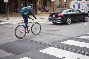 A bicyclist on Spruce crossing the #23 trolley tracks at 12th Street | Photo: Peter Woodall