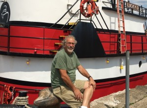 """Hook Line"" Johnny Rizzo, captain of the barge The Chesapeake, in front of the tugboat Lucky D 