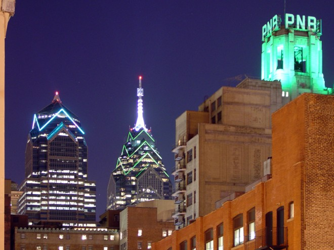 One South Broad with One and Two Liberty Place, lit up in green in January 2005 for the Philadelphia Eagles' appearance in the Super Bowl | Photo: Bradley Maule