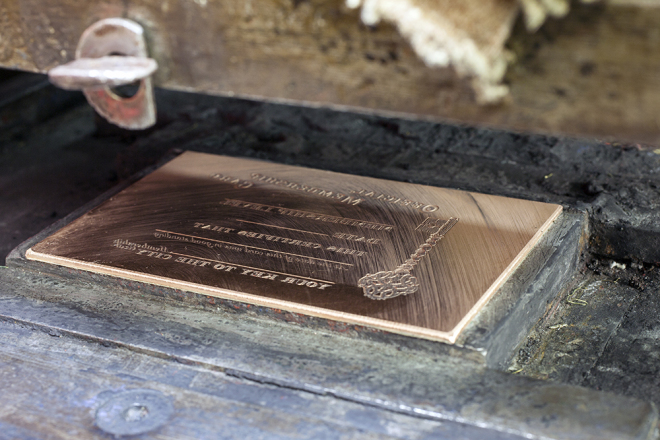 The Hidden City membership card's copper engraving plate in place and ready for the machine to start stamping | Photo: Peter Woodall