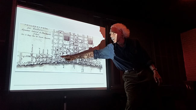 Schreiber points to map of the Philadelphia waterfront in 1776 during a lecture | Photo: Joseph G. Brin
