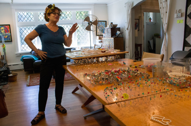 "Amy Orr in her living room converted studio in West Philadelphia. "" I have 10 pole projects beaded up and ready to go,"" says Orr. I don't have specific plans to install in different neighborhoods. I decide more from intuition. I like seeing where the process takes me."" 