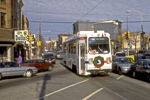 A 1980-model Kawasaki trolley traverses 12th Street south, crossing Passyunk Avenue here in the late 1990s | Photo: Mike Szilagyi