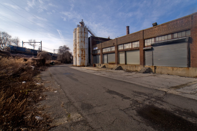 A CSX freight train rumbles past the former Fleer factory on the old Reading Railroad line   Photo: Bradley Maule