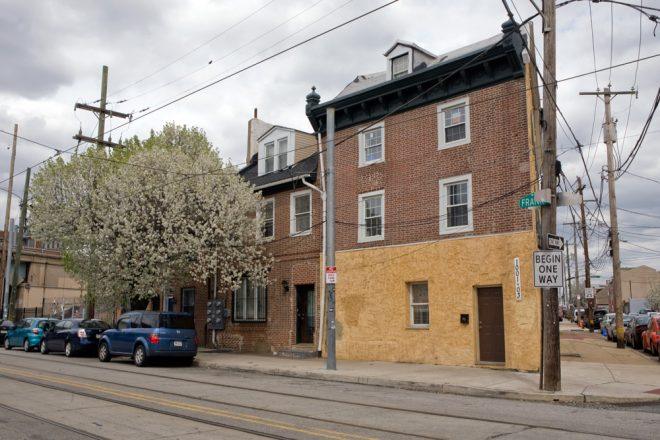 Rapp House, middle building (partially obscured by callery pear blossoms), oldest known residence in Fishtown/Kensington | Photo: Bradley Maule
