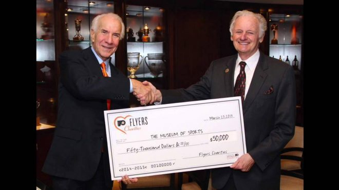 """Late Flyers owner Ed Snider (L) gives former vice president Lou Scheinfeld $50K for the proposed """"Museum of Sports"""" by the stadiums 