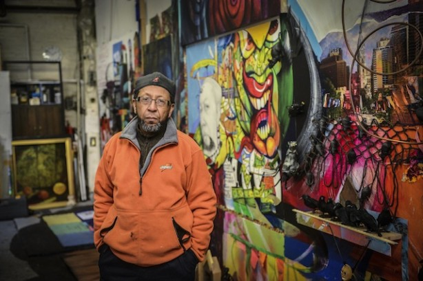 """James Dupree stands before his """"Stolen Dreams in a Promise Zone,"""" 2014   Photo: Charles Mostoller, for Metro"""