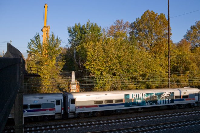 SEPTA's Wilmington/Newark Line passes the Newkirk Monument for the final time as a George Young Company crane prepares its move in November   Photo: Bradley Maule