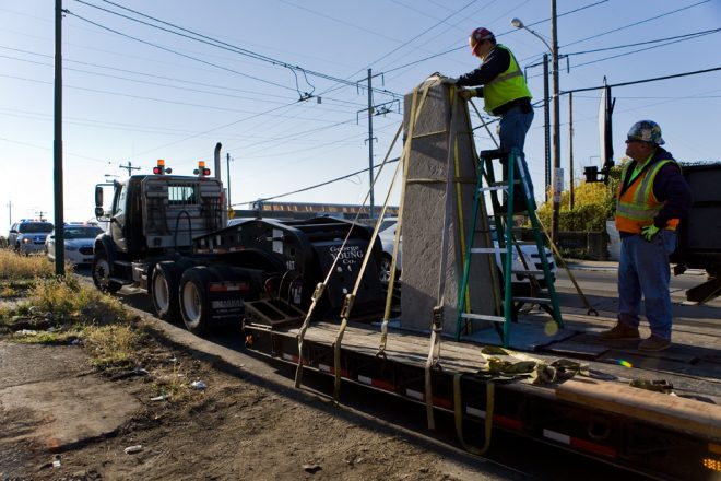 Contractors at George Young Company secure the Newkirk Monument obelisk for relocation on a flatbed truck   Photo: Bradley Maule
