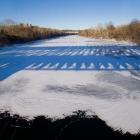Falls Bridge casts its morning shadow on the frozen Schuylkill