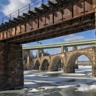 Half a dozen bridges over the frozen Schuylkill