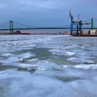 A mostly frozen Delaware River and Walt Whitman Bridge from Proprietors Park in Gloucester City, NJ