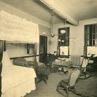 Resident in room circa late 1800's (2)