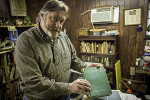 Bookstore owner Greg Gillespie displays a rare original edition of James Joyce's Ulysses | Photo: Theresa Stigale