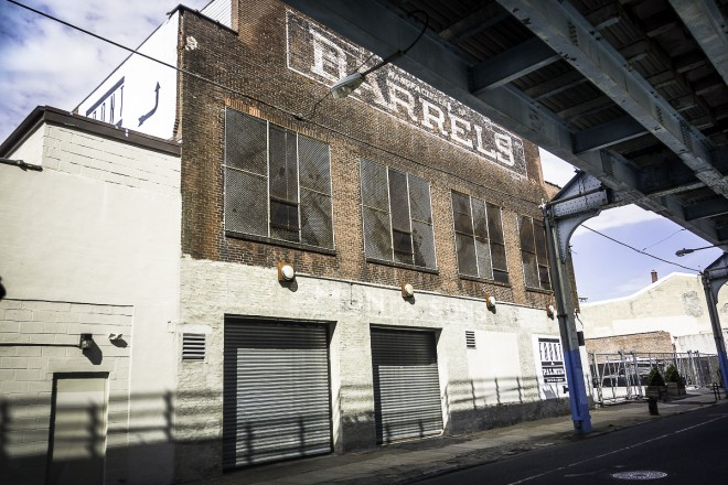 Historic Barrel Factory under the El in Kensington now home to Feast Your Eyes Catering | Photo: Theresa Stigale