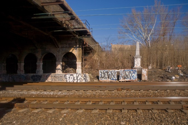 Pedestrians not advised: Newkirk Viaduct Monument seen across the Northeast Corridor | Photo: Bradley Maule