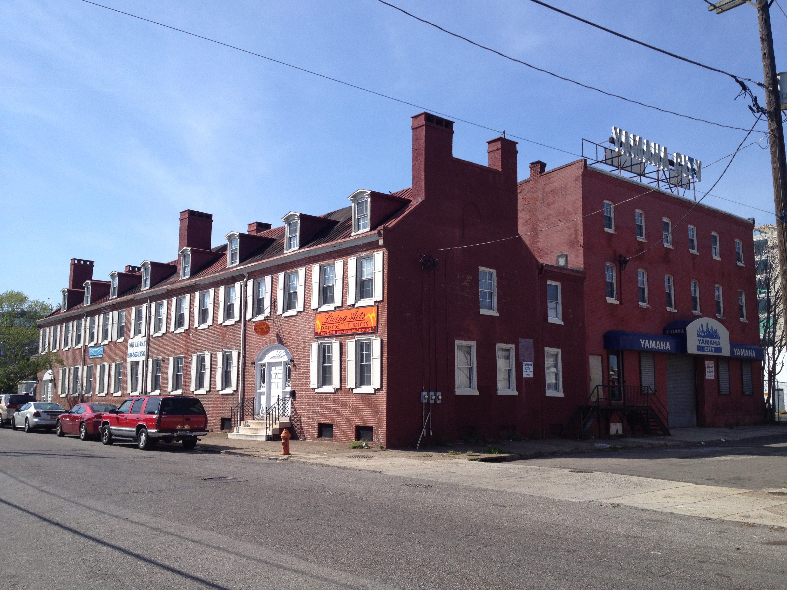 Amidst A Redeveloping Waterfront, An 1830s Row Lives On