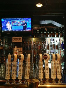 Mind the taps: a sign behind the bar at Manayunk Brewpub marks the high mark of Hurricane Floyd in 1999 (just below TV) | Photo: Bradley Maule