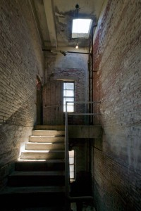 Original brick and stone stairwell | Photo: Bradley Maule