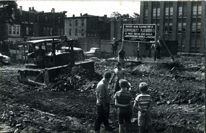 Demolition phase, summer of 1961. Cornman School is visible in the background   Image courtesy of Center of Environmental Design Archive, University of California, Berkeley. Karl Linn Collection.
