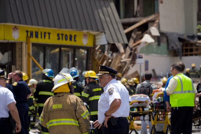 Fire Commissioner Lloyd Ayers and Police Chief Charles Ramsey talk at the scene of yesterday's building collapse | Photo: Bradley Maule