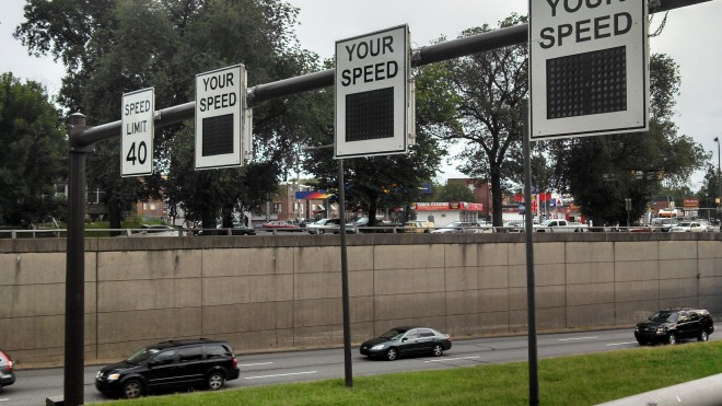 Signs monitor speed under Oxford Circle | Photo: Angela Taurino