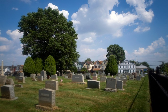 The 18th Century home seen across the 18th Century cemetery across the street | Photo: Bradley Maule