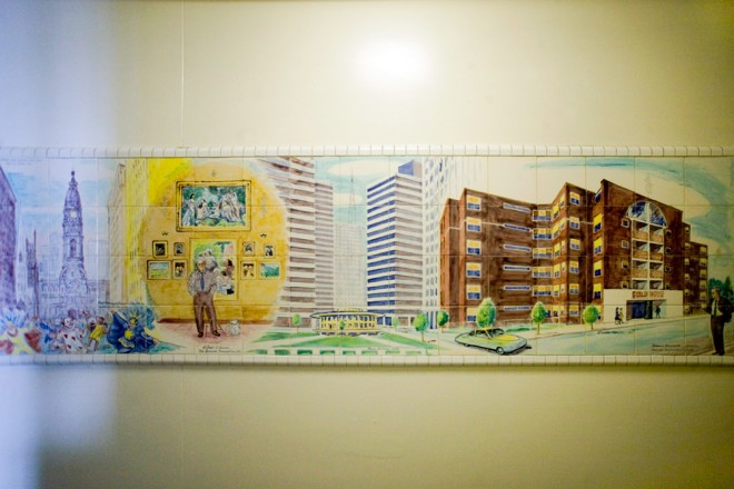 Hand crafted tiled murals adorn the walls of each floor of the Guild House; this one depicts city scenes including the Mummers in front of City Hall, Albert Barnes with his art collection, Penn Center, and the Guild House itself | Photo: Bradley Maule