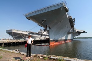 Navy veteran Sarah Thorp stands at the USS JFK, berthed at the Navy Yard | Photo: Bradley Maule