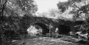 This Library of Congress picture shows the 1805 Poquessing Creek Bridge, located at Philadelphia's northern boundary behind the Lincoln Motel next to Roosevelt Boulevard. The stone arch bridge is within Benjamin Rush State Park.