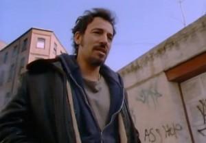 "He walked the avenue till his legs felt like stone | Still from music video for ""Streets of Philadelphia"" (1993)"