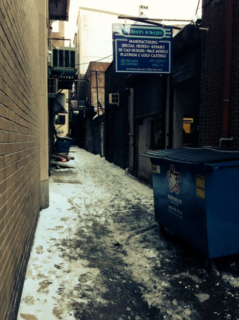 Looking east in the rear pedestrian service alley of the buildings in the 700 block of Walnut and Sansom Streets. Brothers Jewelry has maintained a storefront in this alley for over thirty years | Photo: Oscar Beisert